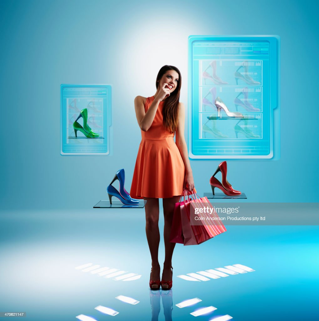 Caucasian woman shopping for shoes online : Stock Photo