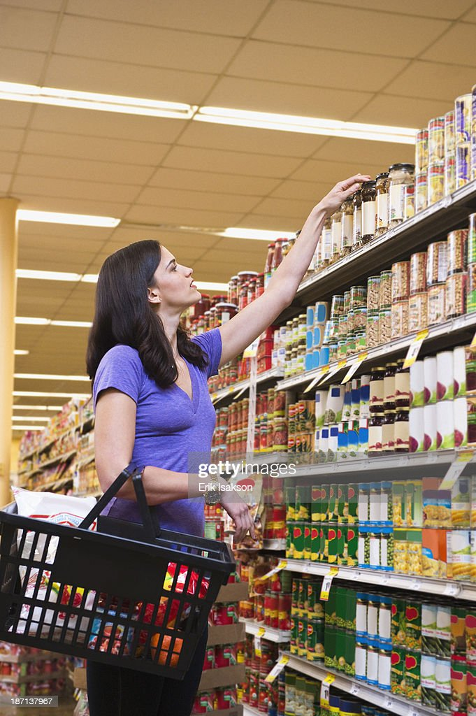 Caucasian woman shopping in grocery store : Stock Photo