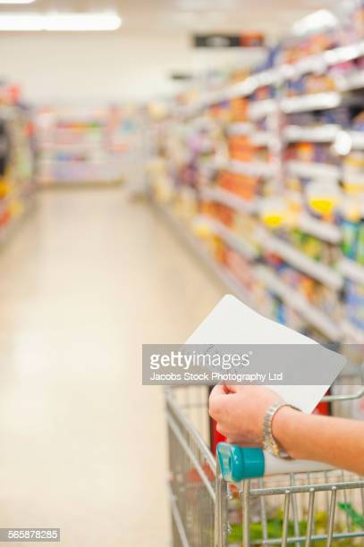 Caucasian woman shopping in grocery store
