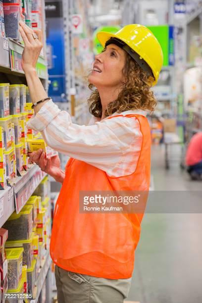 Caucasian woman shopping in hardware store