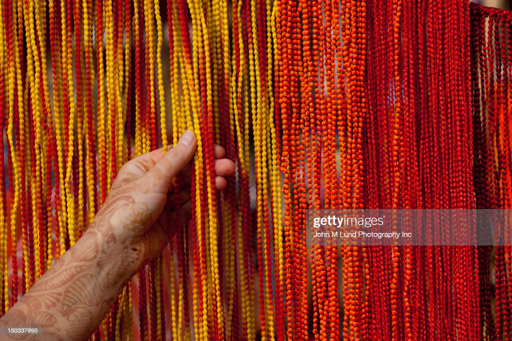 Caucasian woman shops for colorful bead jewelry in  : Stock Photo
