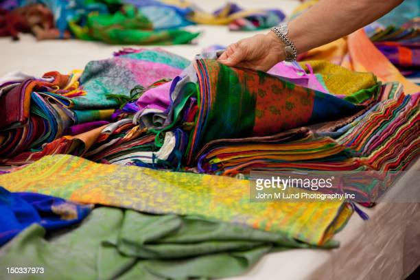 Caucasian woman shops for colorful Indian fabric in