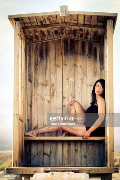 Caucasian woman sitting in cabana on beach