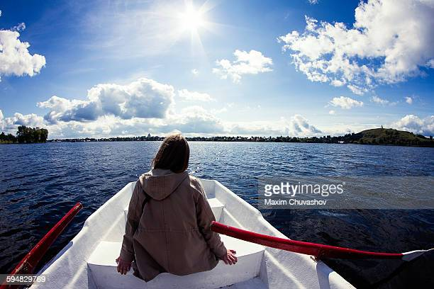 Caucasian woman sitting in rowboat