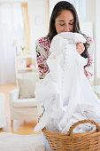 Caucasian woman smelling fresh laundry