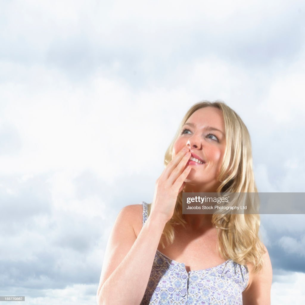 Caucasian woman smiling and looking up : Stock Photo