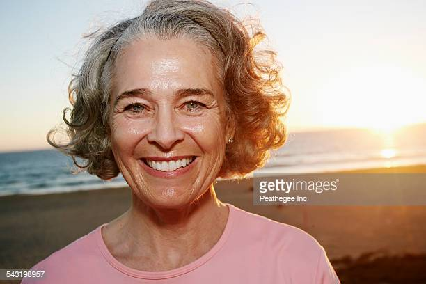 Caucasian woman smiling at beach