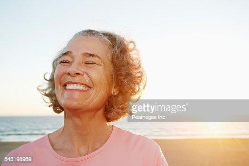 Caucasian woman smiling at beach