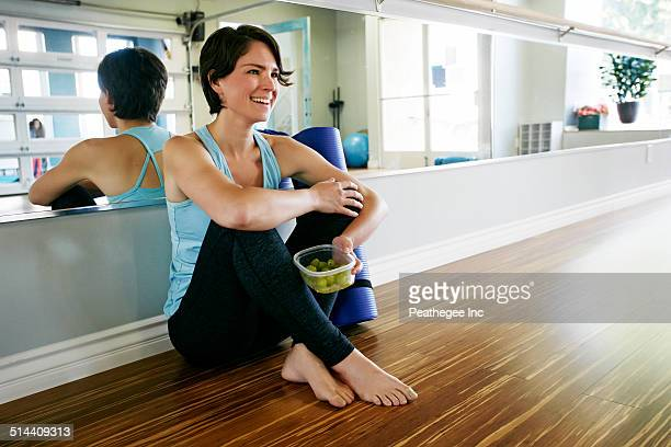 Caucasian woman smiling in yoga studio