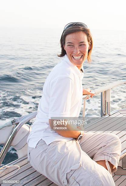 Caucasian woman smiling on boat deck