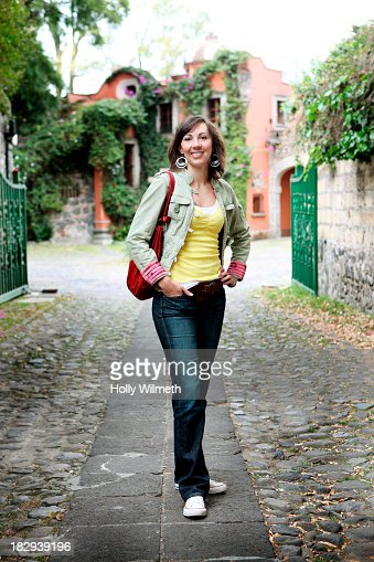 Caucasian woman smiling on city street