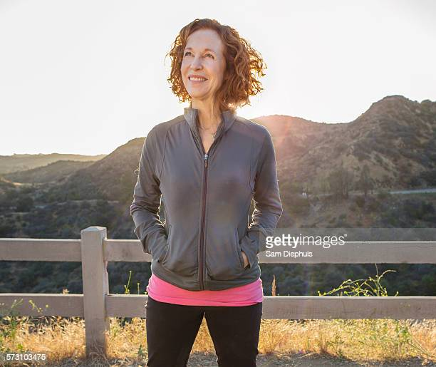 Caucasian woman smiling on hilltop