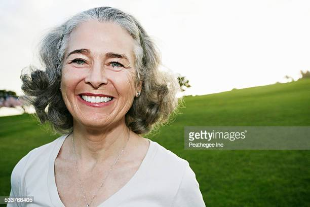 Caucasian woman smiling outdoors