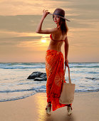 young woman at the beach dress. Isolated with clipping path.