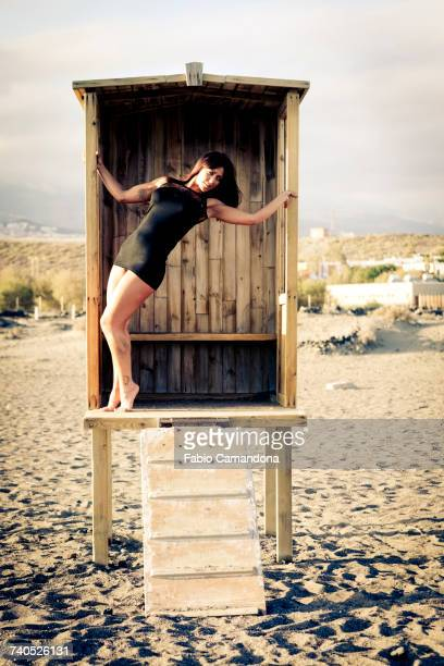 Caucasian woman standing in cabana on beach