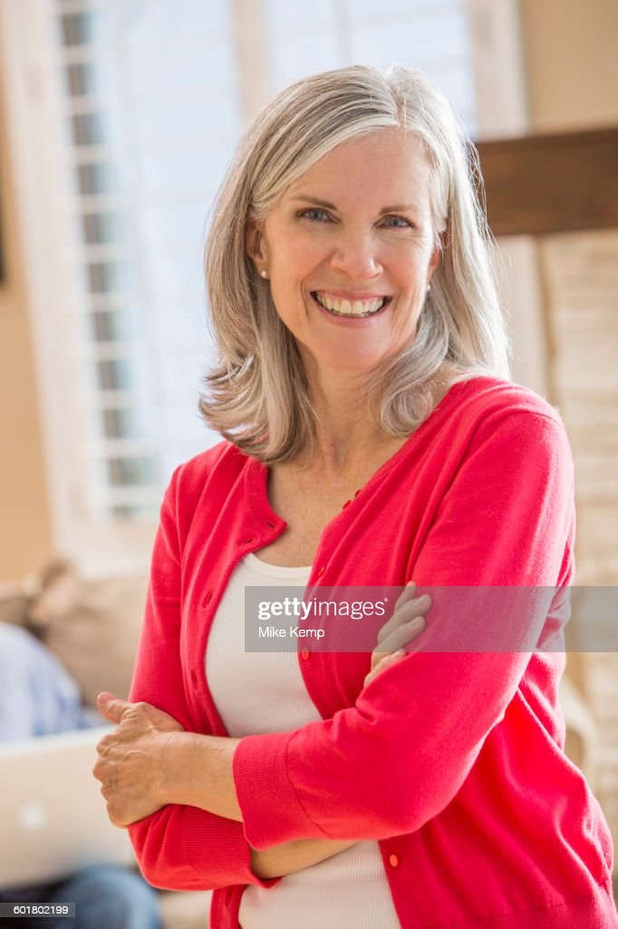 caucasian woman standing in living room stock photo getty images. Black Bedroom Furniture Sets. Home Design Ideas