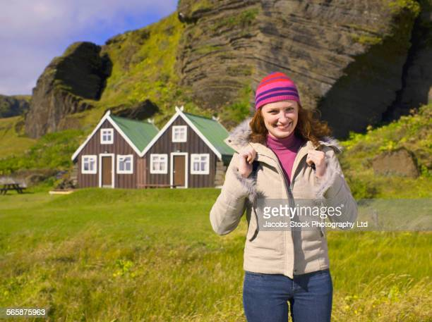 Caucasian woman standing in rural grass field