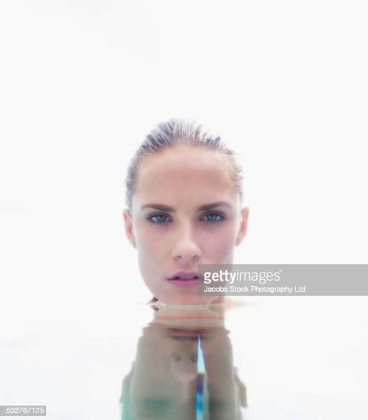 Caucasian woman standing in swimming pool