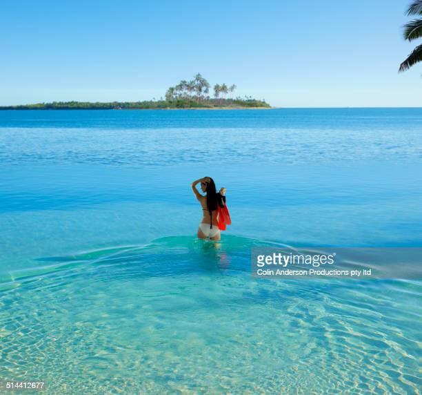 Caucasian woman standing in tropical ocean