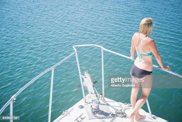 Caucasian woman standing on boat