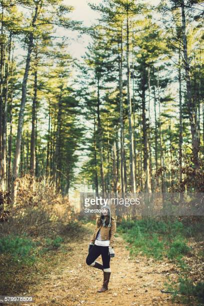 Caucasian woman standing on dirt path