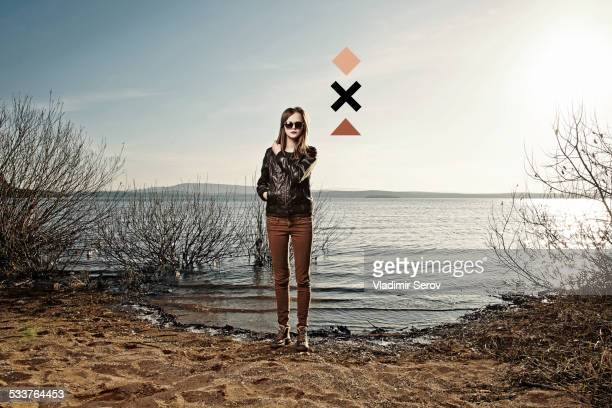 Caucasian woman standing on sandy beach