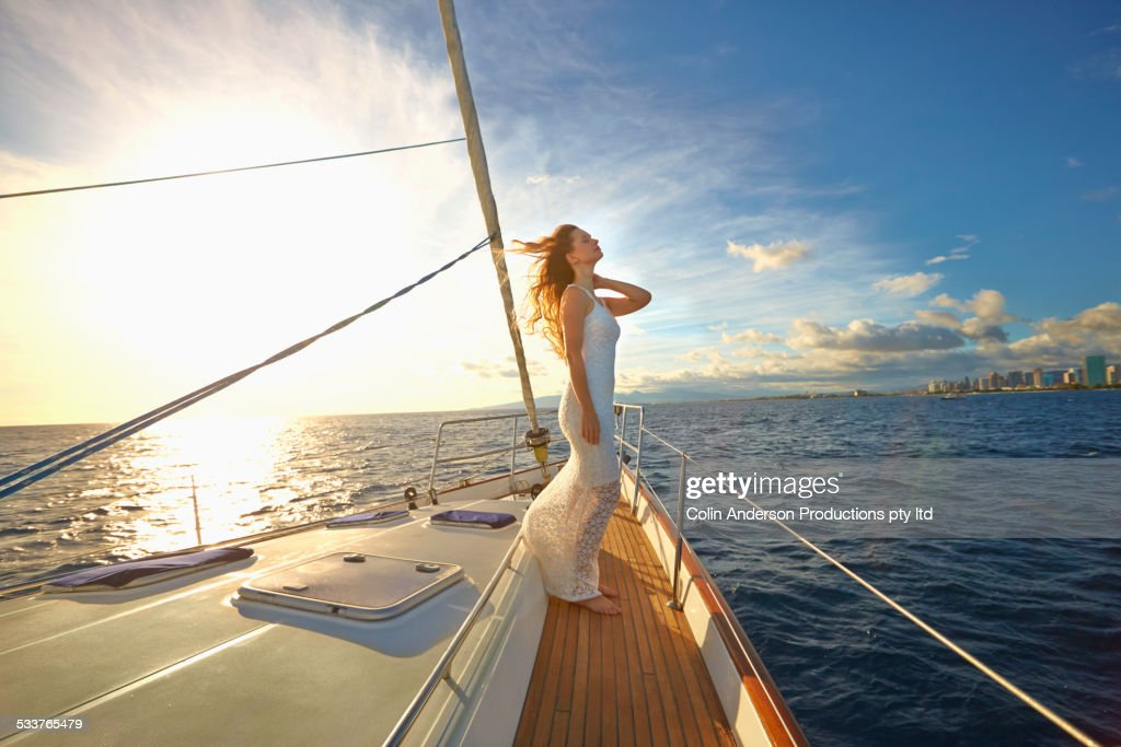 Caucasian woman standing on yacht deck