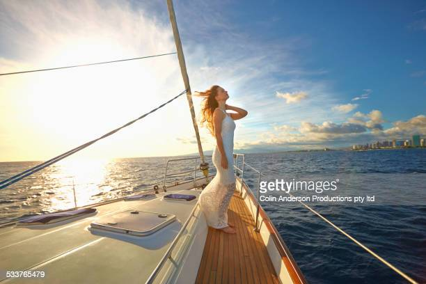 Caucasian woman standing on yacht deck