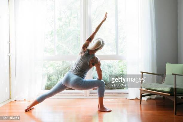 Caucasian woman stretching arms