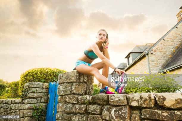 Caucasian woman stretching outdoors