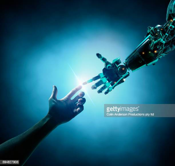 Caucasian woman touching robot arm