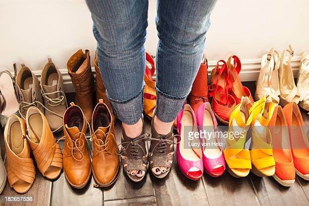 Caucasian woman trying on shoes