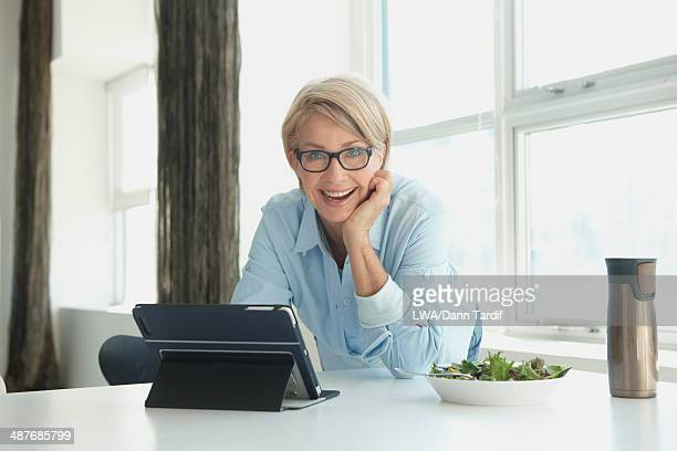 Caucasian woman using digital tablet at lunch