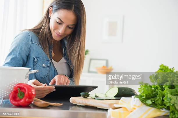 Caucasian woman using digital tablet for recipe