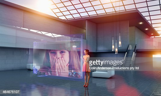 Caucasian woman using hologram computer screen