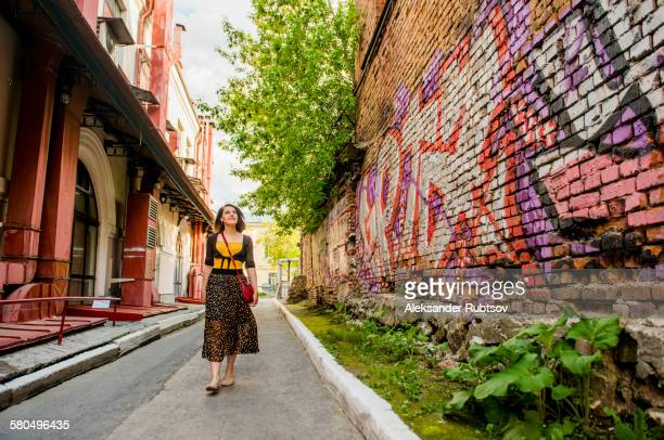 Caucasian woman walking in city street