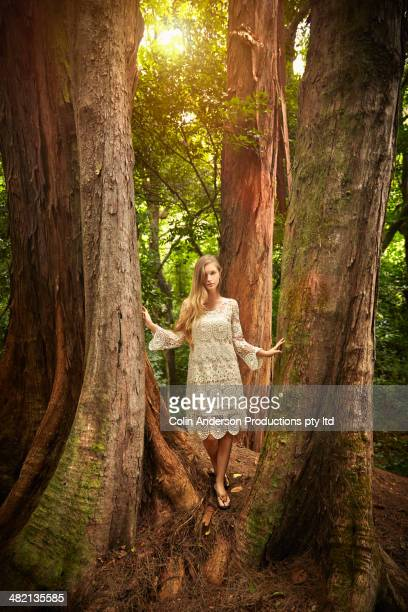 Caucasian woman walking in woods