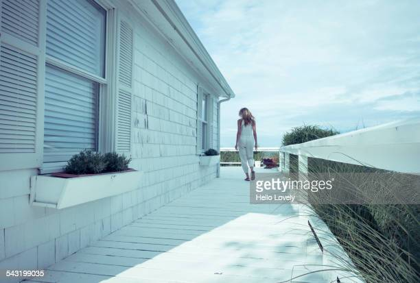 Caucasian woman walking on porch