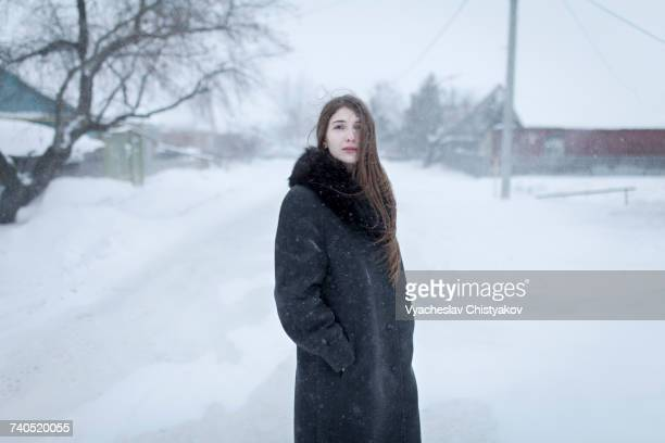 Caucasian woman wearing coat in winter