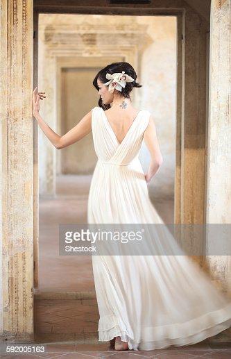 Caucasian woman wearing evening gown