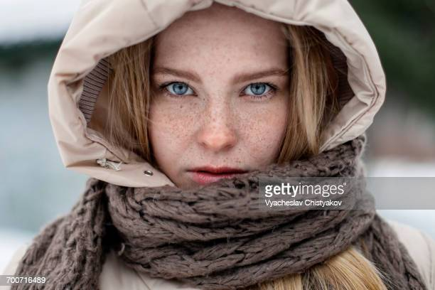 Caucasian woman wearing hood and scarf