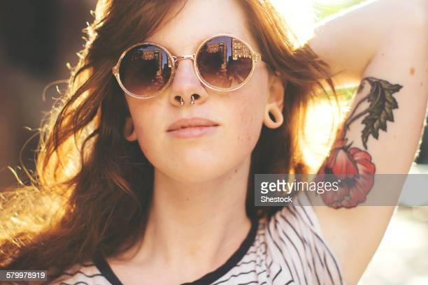 Caucasian woman wearing sunglasses outdoors