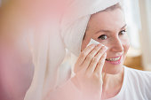 Caucasian woman wiping face