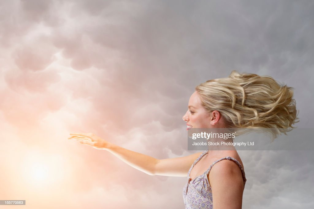 Caucasian woman with arm outstretched : Stock Photo