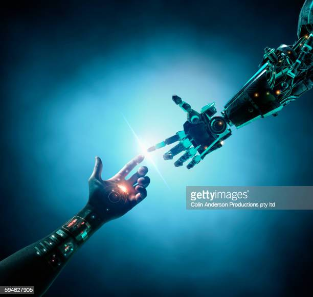 Caucasian woman with bionic technology touching robot arm