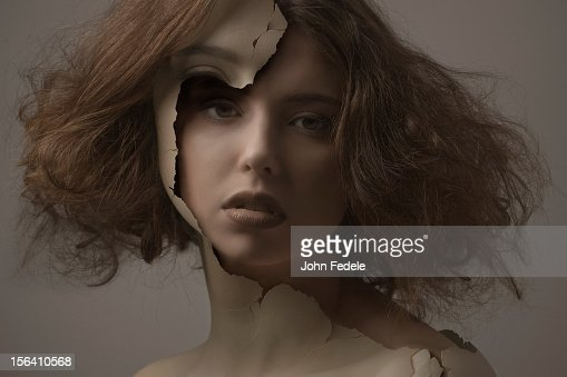 Caucasian woman with broken plastic skin