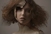 Caucasian woman with broken plastic skin