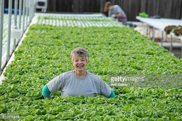 Caucasian woman working in greenhouse