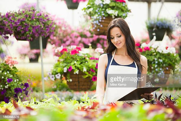Caucasian woman working in plant nursery