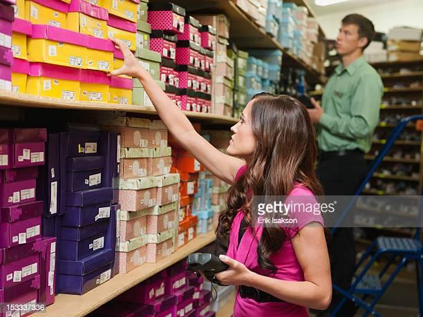 Caucasian woman working in stockroom